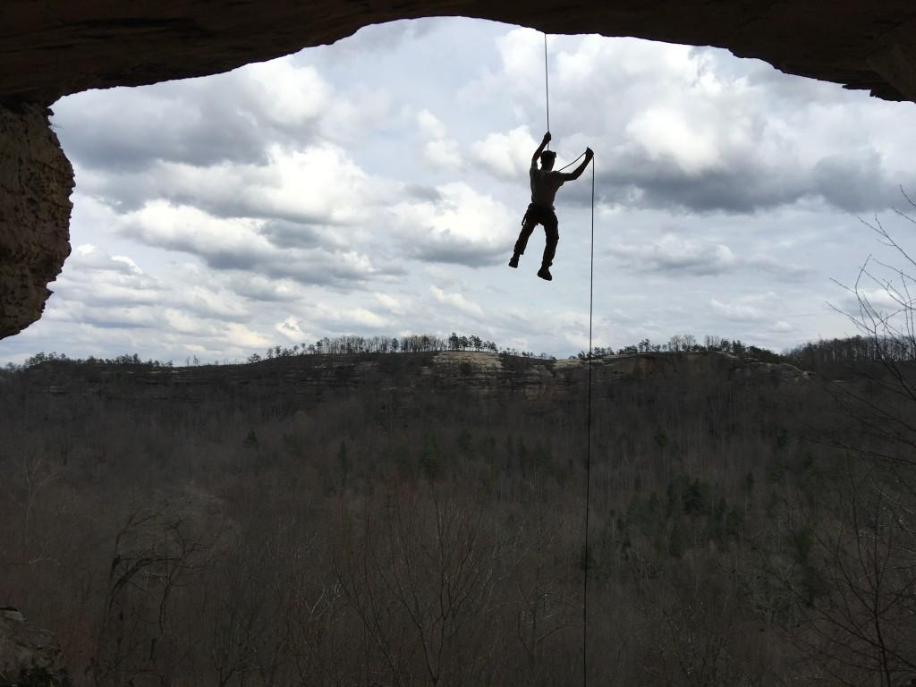 Climber on double arch