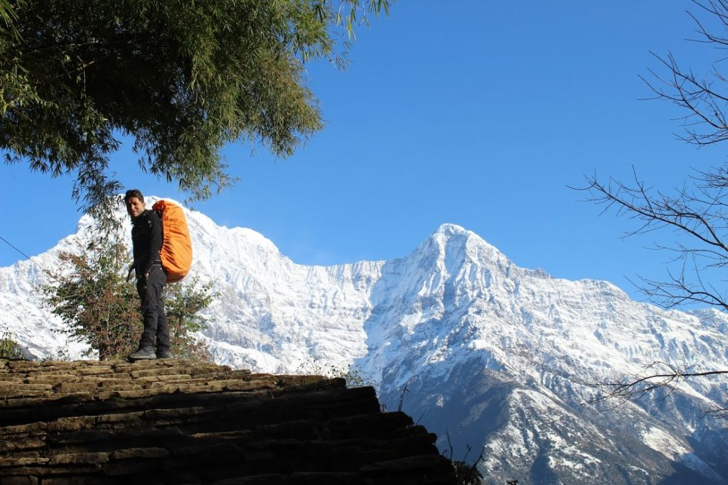 Start of the morning trek towards Chomrong - beautiful clear blue skies and snow covered annapurna mountains over 7000m